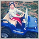 Little man driving his Jeep.